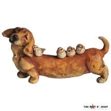 dachshund small dog bird outdoor statue sculpture lawn garden