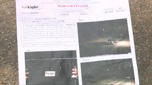 pay red light camera ticket raleigh nc man gets red light ticket in n c when he was at work in richmond