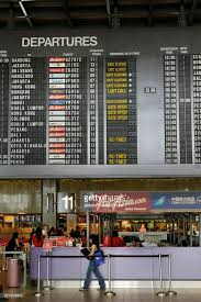 airasia bandung singapore flight departures information screens showing flights for air asia