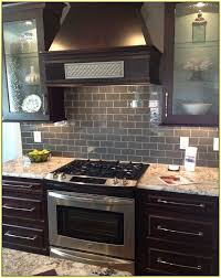 glass tile backsplash with dark cabinets dark gray subway tile backsplash home design ideas