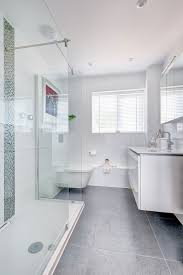 bathroom glass shower partitions ceiling lamps white bathroom