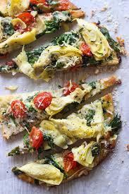 cuisine appetizer artichoke tomato and spinach flatbread broken