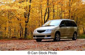 mini infront of orange colored trees during late autumn pictures