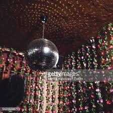 low angle view of disco ball hanging on ceiling against