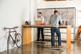 Kangaroo Adjustable Height Desk by 10 Awesome Adjustable Desks To Get You Off Your At Work