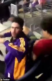 woman throws drink on lakers fans for kneeling for anthem daily