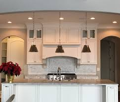 is paint or stain better for kitchen cabinets painted vs stained cabinets knowing which option is best