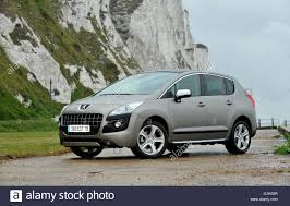 peugeot white peugeot 3008 french mpv car below the white cliffs of dover stock