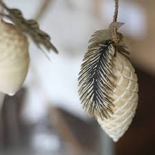 large wooden acorn and pinecone christmas decorations by the