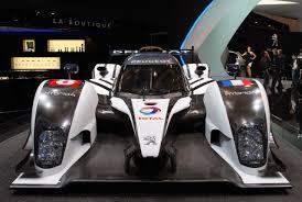 peugeot 909 le mans peugeot unveils 908 hybrid4 le mans racer teamspeed com
