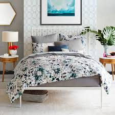 White Metal Bed Frame Stylish Bedroom With Round Nightstands And White Metal Bed
