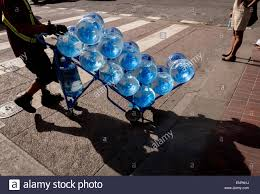 balloons delivery san francisco a delivery person wheels a cart of bottled water across a san