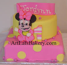 two tier pink and yellow polka dot fondant baby minnie mouse