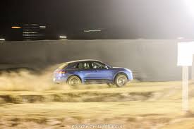 Porsche Cayenne Macan - suave monsters kicking some serious dirt with the porsche