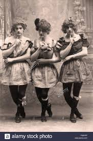 strange portrait of men dressed in woman victorian era stock