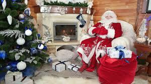 smiling santa welcomes his visitors santa claus greeting