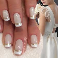 steli u0027s double french manicure in white and gold paired with