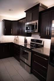 espresso kitchen cabinets with white quartz countertops espresso and cloud white kitchen renovation revival home