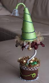 diy christmas topiary trees gold garlands small chocolates