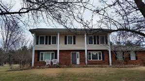 what is a colonial house 70 s colonial exterior facelift