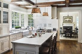 white kitchen cabinets with colored island kitchen cabinets contrasting island coastline cabinetry