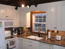 brown granite countertops with white cabinets dark brown countertops white cabinets thefancyteacup com