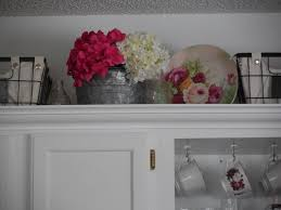 Decorating Above Kitchen Cabinets Best 25 Above Cabinet Decor Ideas On Pinterest Above Kitchen