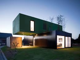 crossbox is a modern modular house with cantilevered upper floor