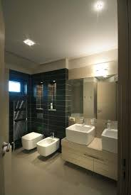 home project luxury bathroom design with plain black tiles and hidden lights by