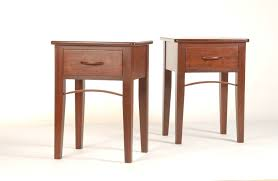 cherry wood nightstand with single drawers and brown wooden handle