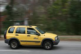 file 2009 03 11 yellow chevy tracker on n gregson st in durham jpg