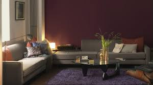 brown wall living rooms colours with grey sofas and cushion on the