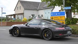 camo porsche 911 porsche 911 facelift spied without camo 26 pics