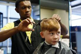 families take advantage of free back to haircuts at clary