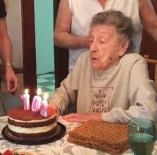 102 year old louise bonito blows out birthday candles but loses