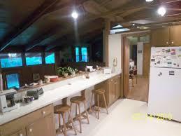 large floor ceiling windows provide views patio parklike open