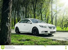 opel russia car opel insignia stand on asphalt road in green forest at daytime