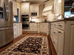 medallion cabinets for a mediterranean kitchen with a tile