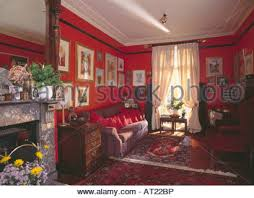 red patterned carpet and cream curtains in beige townhouse living