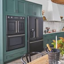 black kitchen cabinets with black appliances photos shop café at lowe s refrigerators wall ovens and more