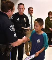 family at thanksgiving dinner behind the badge at risk kids in fullerton earn thanksgiving