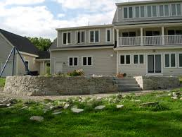 Building A Raised Patio With Retaining Wall by Maine Stonework Masonry Hardscaping Perennial Stone Raised