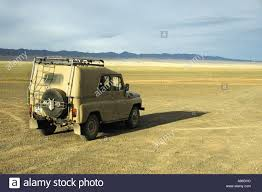 wide jeep russian jeep uaz in wide open steppe landscape camp tuvshin