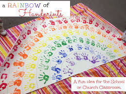 a rainbow of handprints celebrate every day with me