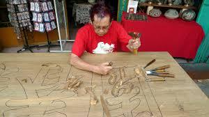 wood sculpture singapore entertainer my artist friend on newspaper