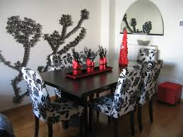 dining room with flowers and candle on square plate dining room