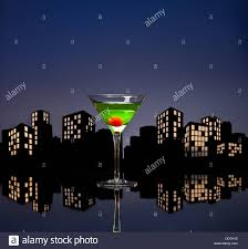 metropolis apple martini cocktail in skyline setting stock photo