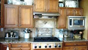above kitchen cabinet ideas ideas for above kitchen cabinets 1 put some baskets up there and