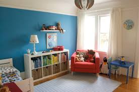 charming kid room design featuring orange wall paint themes ideas