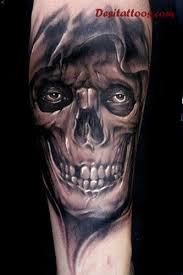 black and grey 3d horror skull on forearm